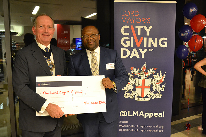 The Lord Mayor receives a cheque from Johnson Ememandu, Head of Commercial Banking at The Access Bank UK.